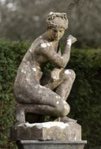 Garden statues: After the Antique: An Austin and Seeley composition stone figure of the crouching