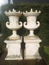 Garden pots and urns: A pair of impressive and unusual cast iron lidded finials on pedestals,