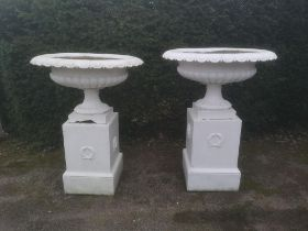 Garden pots and urns: A pair of large cast iron urns on pedestals, 2nd half 19th century, 126cm
