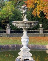 Water features and fountains: A carved white marble fountain, Italian, circa 1900, surmounted by a
