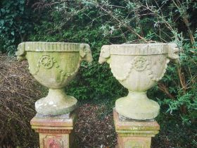 Garden pots and urns: A pair of carved stone urns, 19th century, 66cm high , From a Private