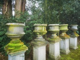 Garden pots and urns: A set of five Victorian carved sandstone urns, mid 19th century, 83cm high