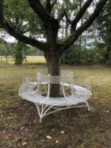 Garden seats: An Arras wrought iron tree seat in two halves, early 20th century, with maker's