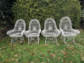 Garden chairs: A rare set of four wirework seats, early 20th century