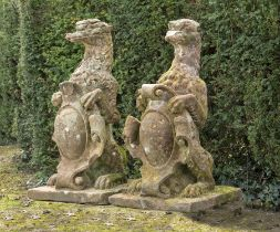 Garden statues: A pair of Victorian carved red sandstone armorial gate pier beasts, circa 1860,