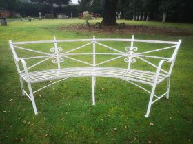 Garden seats: A pair of rare Regency reeded wrought iron curved seats, early 19th century, 270cm