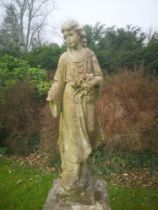 Garden statues: A carved white marble figure of a girl holding flowers, 122cm high , From a