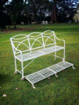 Garden seats: A Regency reeded wrought iron games seat, early 19th century, with hinged footrest,