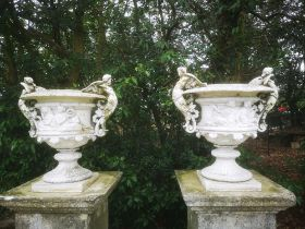 Garden pots and urns: A pair of rare cast iron urns, probably by Fiske, American, 76cm high, From