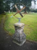 Sundial: A wrought iron and zinc armillary on Louis XVth style composition stone base, late 19th/