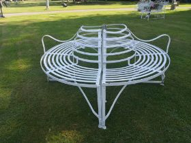 A wrought iron strapwork tree seat
