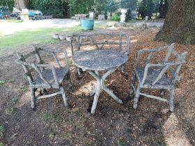 A rare suite of faux bois composition stone furniture