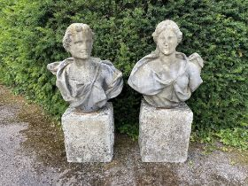 A pair of carved white marble busts of Bacchus and Diana