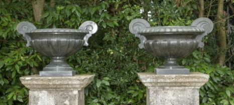 A pair of unusual carved green granite urns
