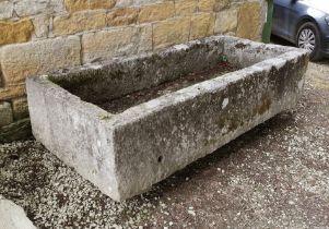 A substantial stone trough