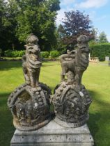 A pair of unusual composition stone armorial crowns