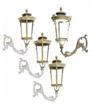 A pair of impressive brass/bronze wall lanterns with cast iron brackets