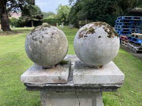 A pair of composition stone gate pier balls