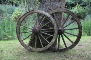 A similar smaller pair of wagon wheels