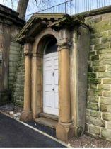 An historic Georgian carved sandstone door surround and painted pine door