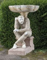 A carved marble and stone figure of a man supporting a bowl