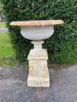 A similar smaller Handyside foundry cast iron urn on pedestal