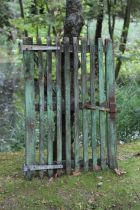 Two green painted wooden gates