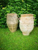 A pair of terracotta storage jars