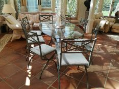 A suite of painted metal dining room furniture