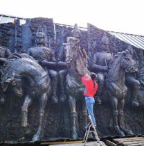 A monumental and impressive bronze patinated fibreglass wall sculpture