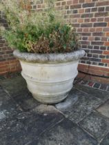 A pair of substantial composition stone tapering cylindrical planters