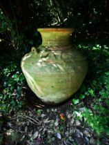 A terractotta storage jar