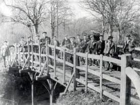 THE HISTORICALLY IMPORTANT POOH STICKS BRIDGE FROM ASHDOWN FOREST A carved oak bridge circa...