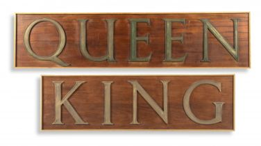 A Queen sign with bronze letters
