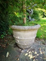 A similar smaller pair of composition stone tapering cylindrical planters