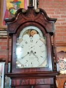 An 8 day longcase clock with painted face by R Lawson Hindley