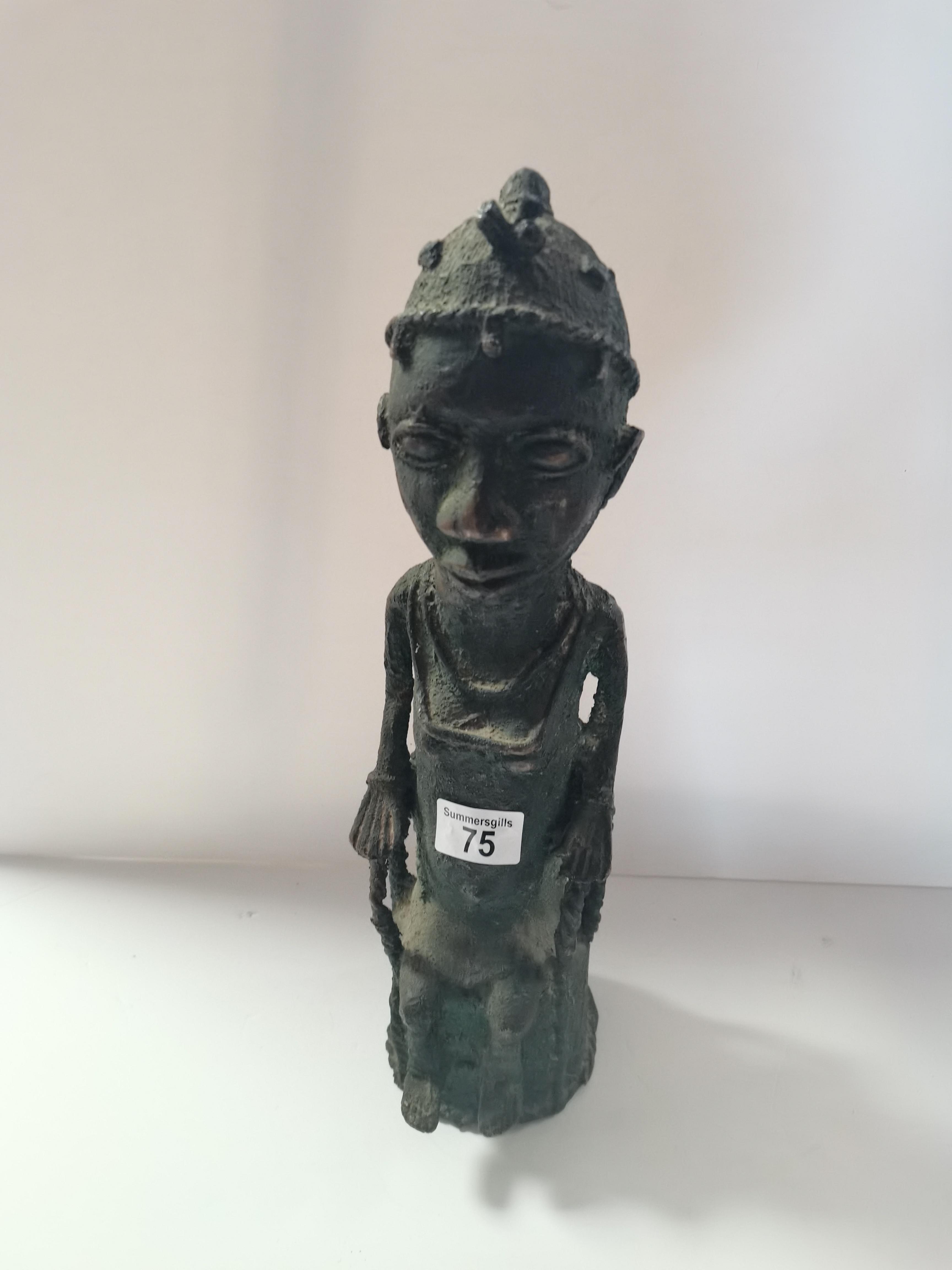 Benin bronze style figure of a seated man 43cm