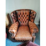 Brown leather button backed arm chair