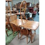 Ercol table and 5 ercol spindle backed chairs