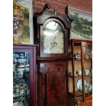 Grandfather clock with painted face with lion decoration