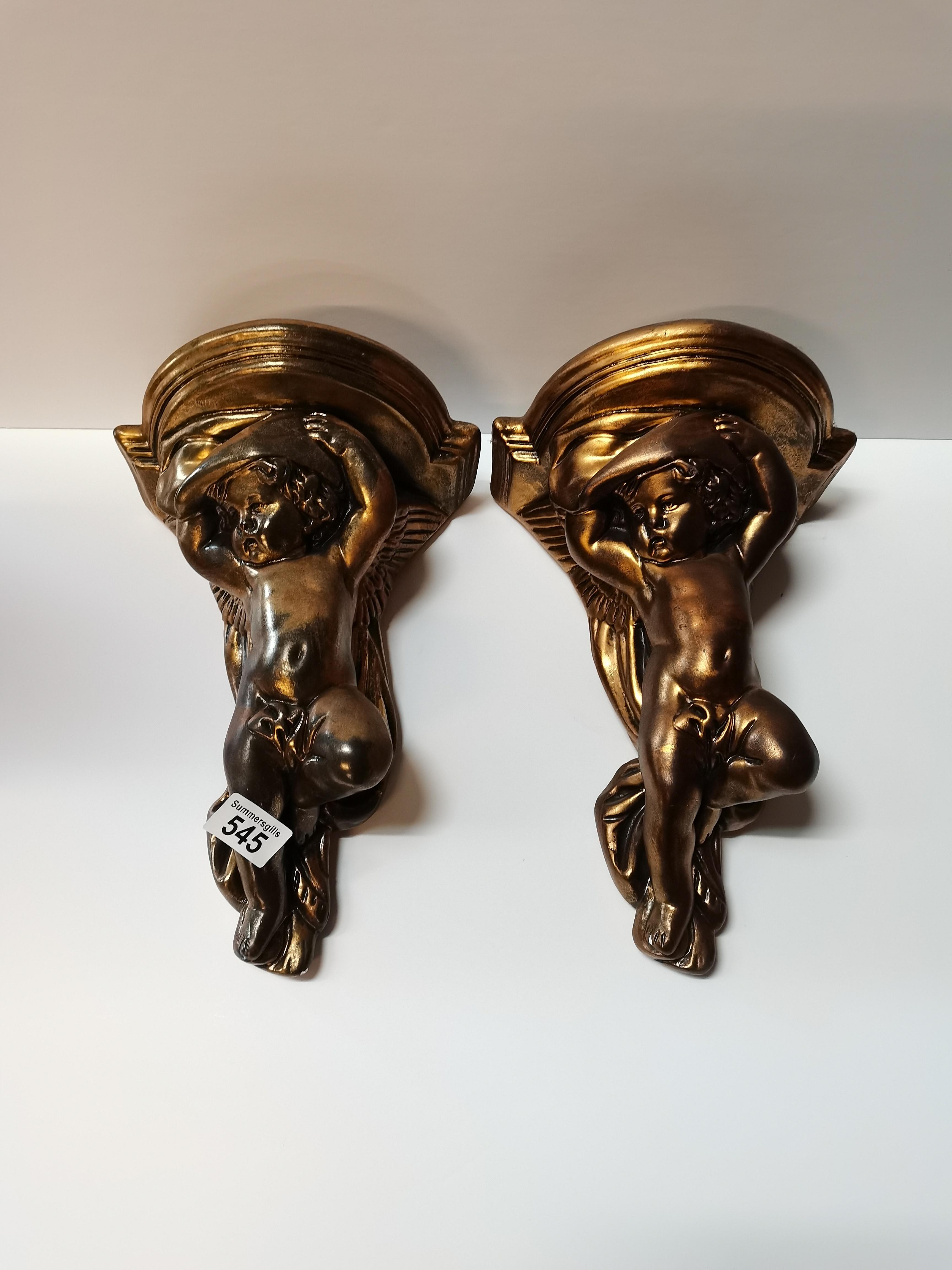 Pair of plaster cherubs