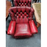 Pair of red leather suite / arm chairs