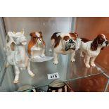 Beswick Standing Bulldog, Beswick Spaniel, Beswick Dairy Cow and a Royal Doulton Sitting Bulldog