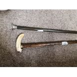 Silver topped walking stick and bone topped stick