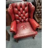 Red leather button backed arm chair