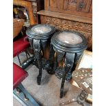 Pair of Antique plant stands heavily carved with elephants and marble topped
