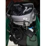 A Very Large Collection Of Photographic Equipment Including Tripods Bags Cameras and Numerous Lenses