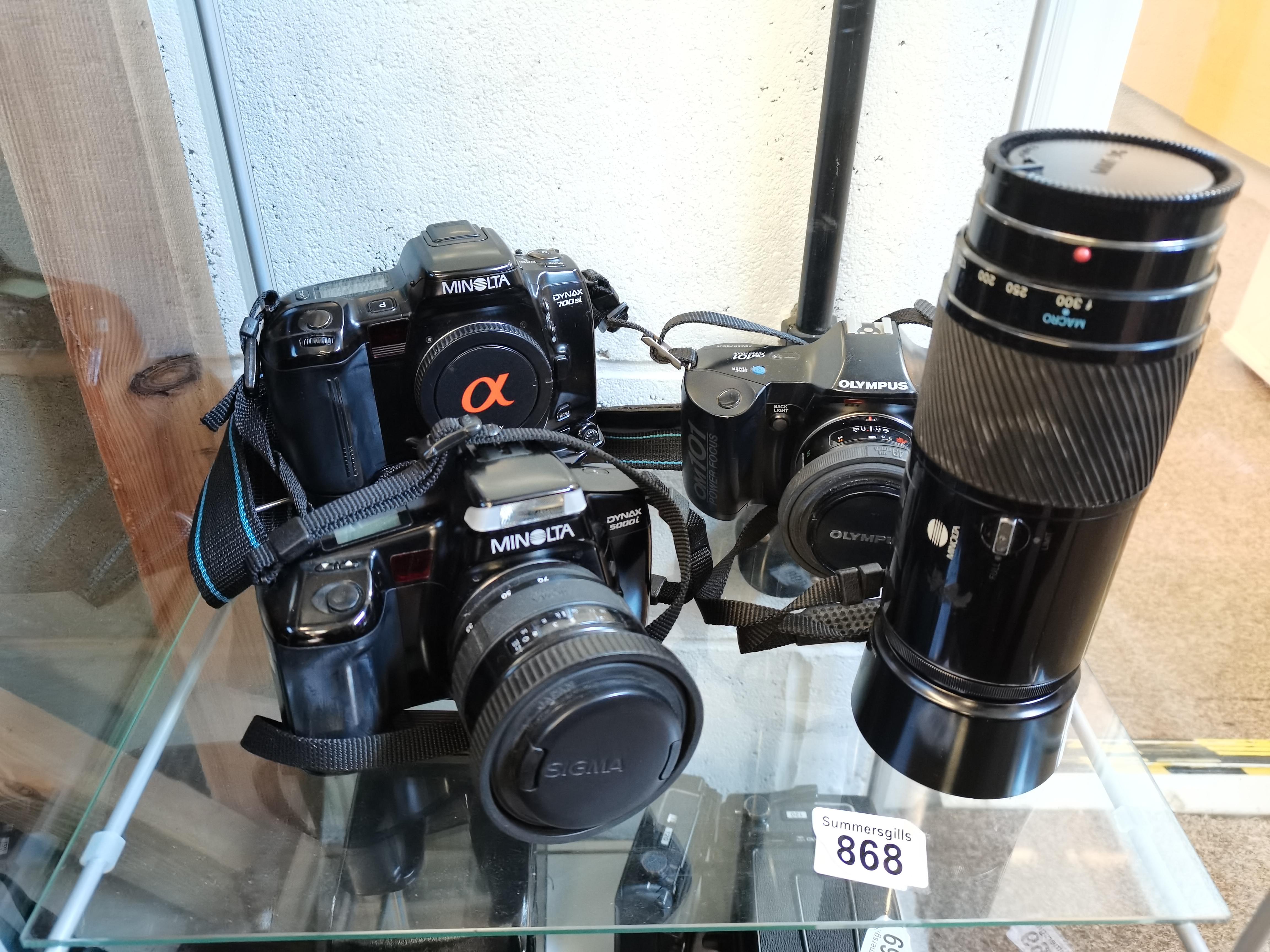 3 Camera's 2 Minolta 5000i and 700si and 1 Olympus OM101 Plus 2 Lenses a Minolta