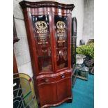 6ft high mahogany corner cupboard marked Gucci