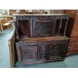 Early oak carved court cupboard with twisted supports and carved doors